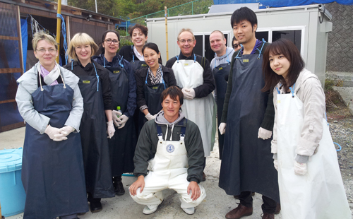 Members of the research team visiting Minamisanriku with a local fisherman