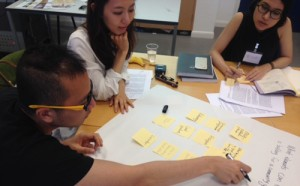 Designers cooperate to develop presentation outlines