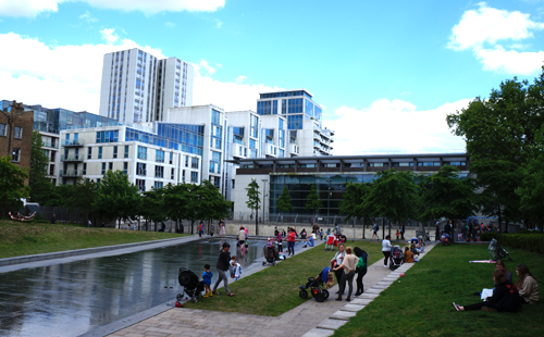Families engaging with the site's water feature