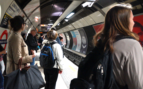 Londoners sharing space while waiting for the tube in the London Bridge Underground Station